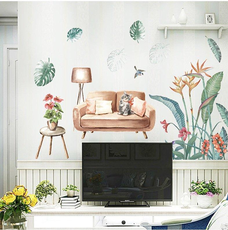 Decal dán tường mèo ngồi trên sofa và lá xanh