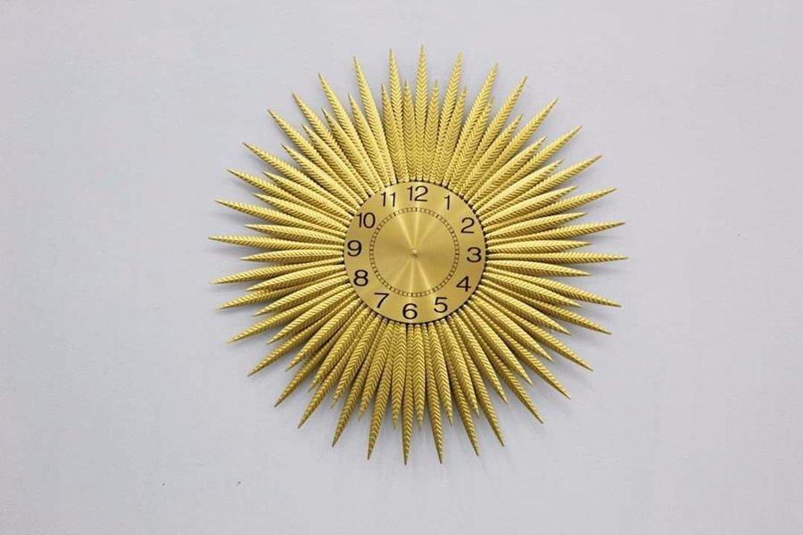 Đồng hồ đính đá mặt trời vàng